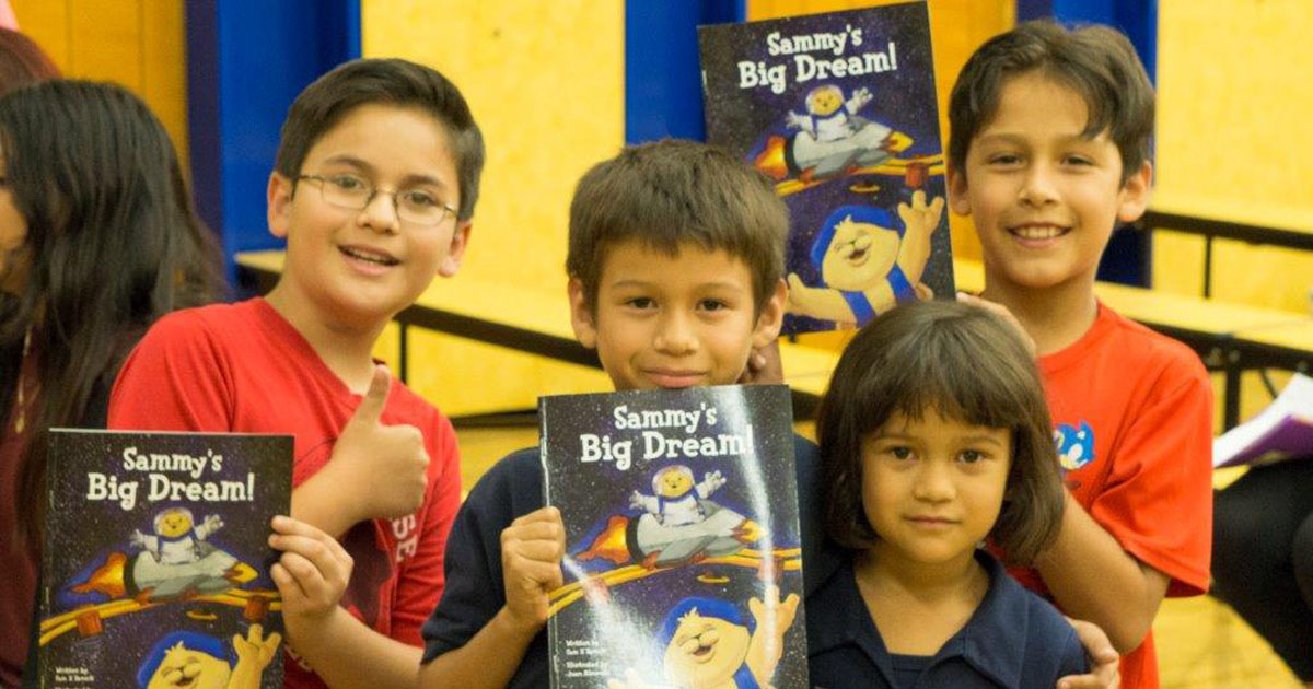 Kids at Malabar Elementary School in East Los Angeles receive copies of Sammy's Big Dream