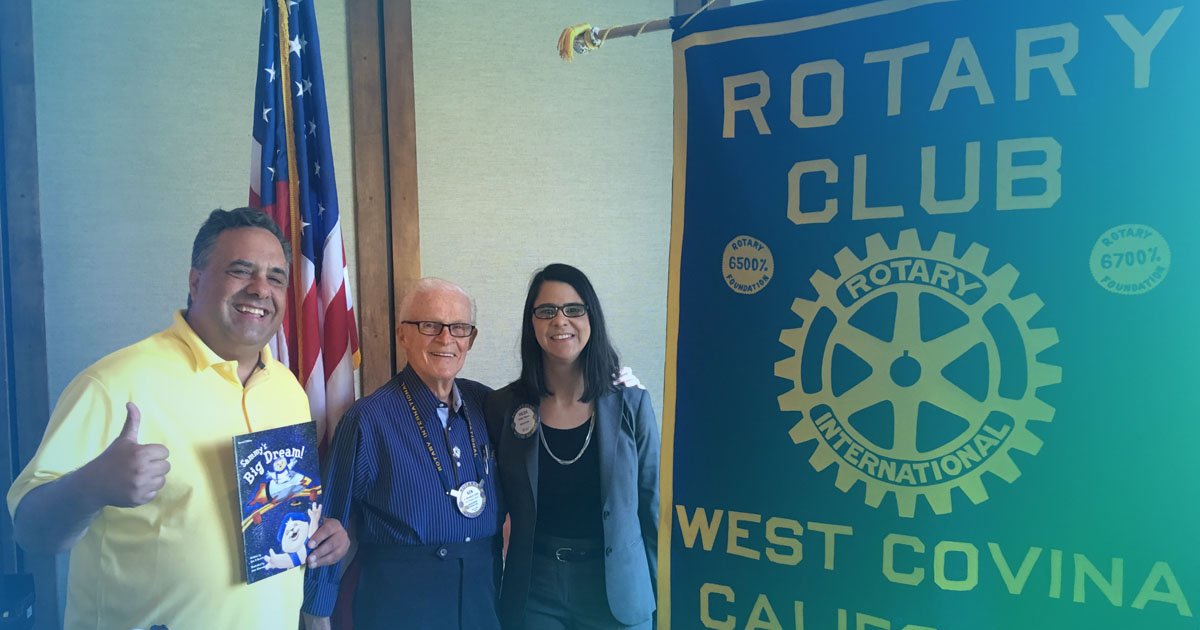 Sam X Renick with Sammy's Big Dream story book at West Covina Noon Rotary Club