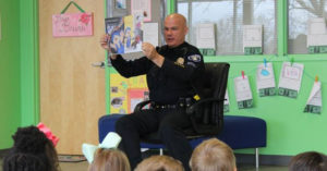 Officer Tommy Norman reads Sammy's Big Dream